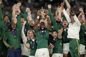 South Africa captain Siya Kolisi lifts the Web Ellis Cup following their emphatic victory against England at Yokohama International Stadium.