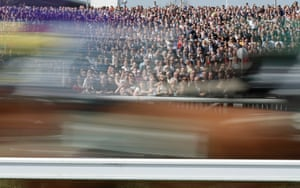 Runners fly past the open standing area during the second race of the day, the Beway Mersey Novices' Hurdle, which was won by Noel Fehily on Black Op