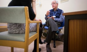 Professor George Tadros of the mental health team at Heartlands Hospital in Birmingham chats to a patient