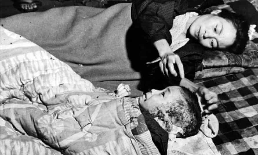 A mother tends her injured child after the atomic bomb blast at Hiroshima.