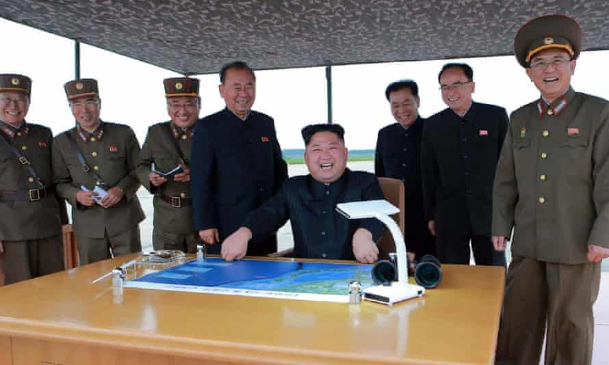 Kim Jong-un watches the launch of an intermediate-range missile, in an image released by North Korea's official KCNA news agency.