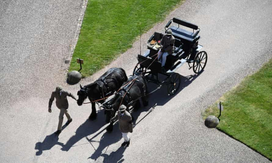 Fell ponies pull the Duke of Edinburgh's carriage as it arrives at Windsor Castle on the day of the funeral.