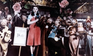 'They would make Judy's life miserable' … Judy Garland with munchkins in The Wizard of Oz.