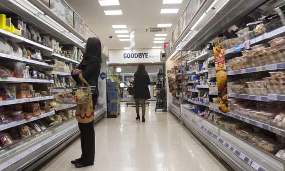 People in the aisles of a Tesco supermarket