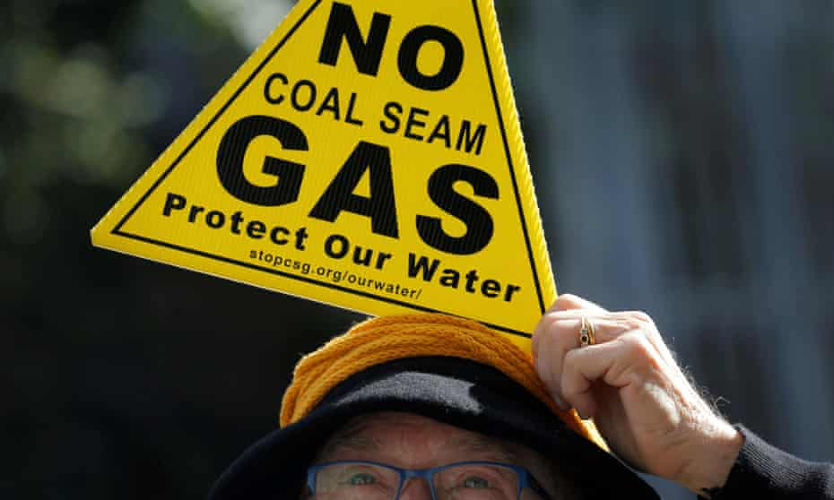 woman with a no coal seam gas sign