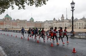 The men race past Horse Guards Parade.