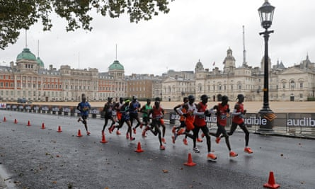 A group of elite male competitors races past Horse Guards Parade in the London Marathon on Sunday.