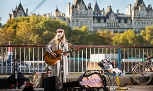 Busker Charlotte Campbell on the South Bank, London.