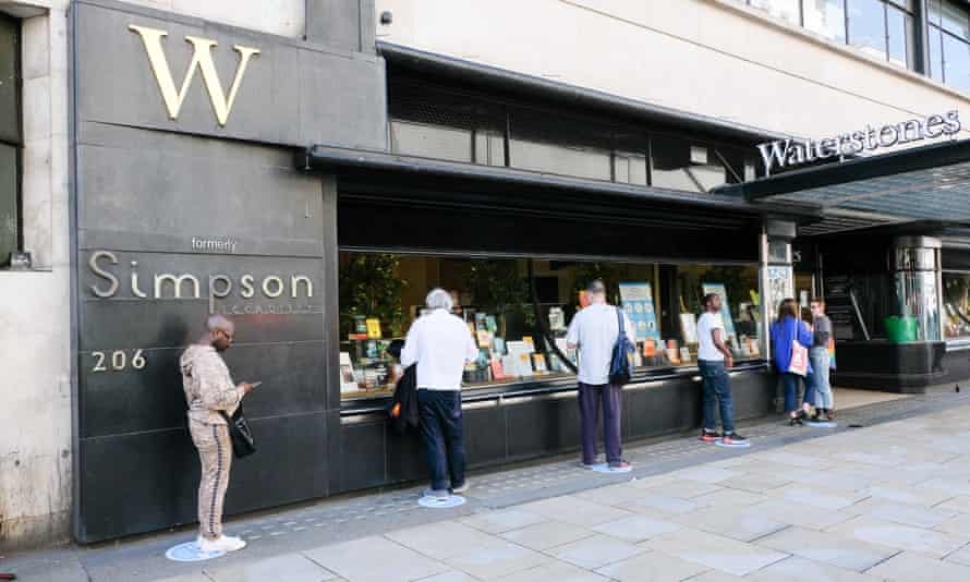 Customers queue outside Waterstones in Piccadilly, London on 15 June, the day bookshops reopened in England.