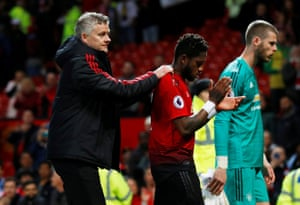 Manchester United manager Ole Gunnar Solskjaer, commiserates with Fred as they and United keeper David de Gea trudge off the pitch.