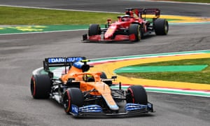 Norris of Great Britain overtakes Charles Leclerc