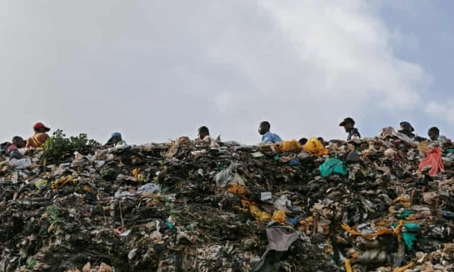 Plastic bags stick out of a pile of rubbish in the Kibera slum in Nairobi, Kenya.