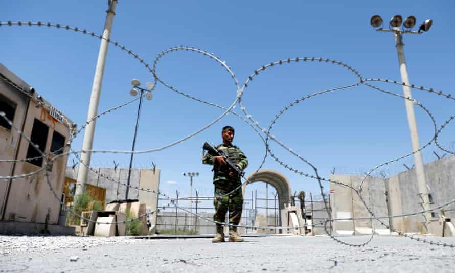 An Afghan national army soldier stands guard at Bagram on the day the last of the American troops vacated the airbase