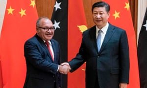 Papua New Guinea's prime minister Peter O'Neill shakes hands with China's President Xi Jinping in Beijing in 2018