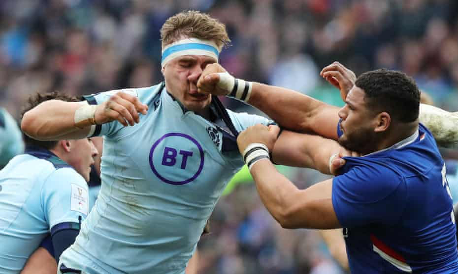 Mohammed Haouas of France punches Scotland's Jamie Ritchie in the first half at Murrayfield. The France prop was sent off.