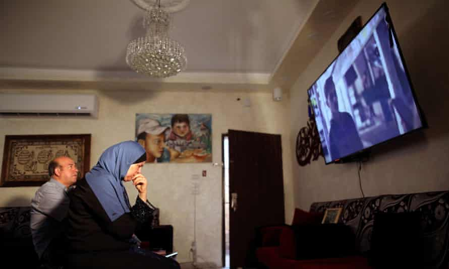 Hussein and Suha Abu Khdeir, whose son's murder is portrayed in Our Boys, watching the opening episodes in their East Jerusalem home.