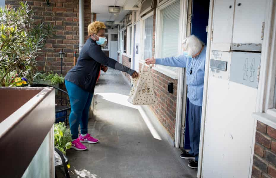 Latoya Stephens delivers the weekly shop to Betty Johnson, 92, a retired nurse.