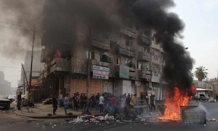 Burning tyres in front of a building in Baghdad