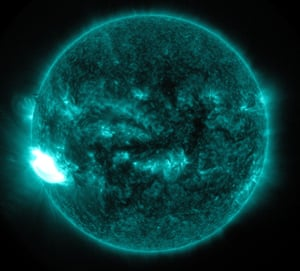 Extreme ultraviolet image of the Sun showing a solar flare on the left side
