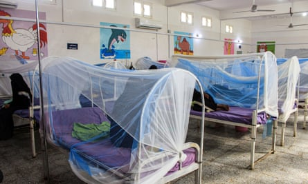 Women wait with children in a ward at a malnourishment treatment centre in Yemen's northern Hajjah province.