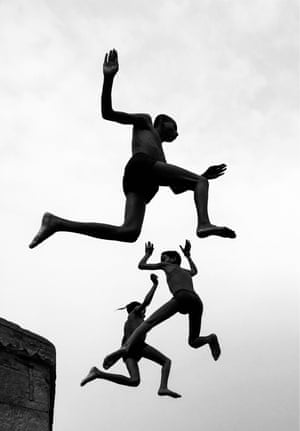 Dimpy Bhalotia, Flying BoysThese boys living in Varanasi, India, were jumping off a man-made cliff into the Ganges to beat the summer heat. They are a symbol of fearlessness and freedom