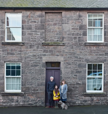 Illustrators Helen Stephens and Gerry Turley, with their daughter, Frieda, and dog Peggy outside their house in Berwick-upon-Tweed