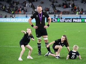 Kieran Read watches his kids Elle, Eden and Reuben play on the pitch following his last game for the All Blacks.
