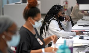 Contact tracker Kandice Childress, right, works at Harris County, Public Health Tracking Contact, June 25, 2020, in Houston.