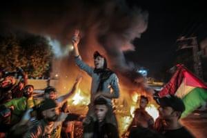 Smoke hangs over protesters