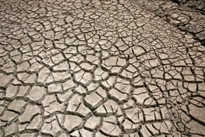 Cracked ground is pictured at the dried Ajuan Khota dam, a water reserve affected by drought near La Paz