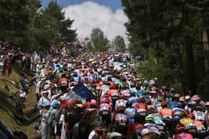 The pack rides between Saint Etienne and Brioude during the ninth stage of the Tour de France on 14 July.