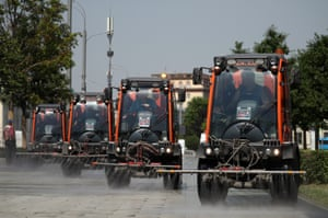 Service vehicles spray water down Novinskiy Boulevard to protect the road surface from overheating