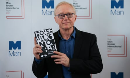 David Grossman poses with his book A Horse Walks Into a Bar.
