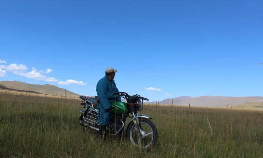 A herder on motorcycle in Bayankhongor province, Central Mongolia.