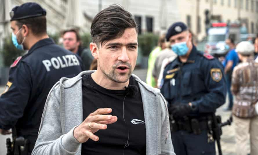 Martin Sellner, leader of the far-right Identitarian Movement Austria, at a demonstration on Friday against his government's measures to slow down the spread of coronavirus.