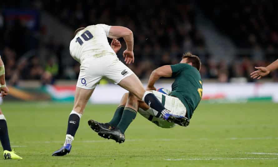 Owen Farrell of England tackles Andre Esterhuizen.