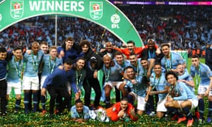Manchester City's players celebrate after beating Chelsea to win the 2019 Carabao Cup