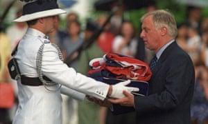 Hong Kong governor Chris Patten receives the Union Jack flag on 30 June, 1997 after it was lowered for the last time at Government House, the governor's official residence. The ceremony marked the end of some 156 years of British colonial rule as the territory returned to Chinese control.