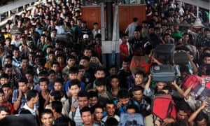 Crowds at a railway station in India. The WHO says the population will peak in 2050 at 1.7bn.
