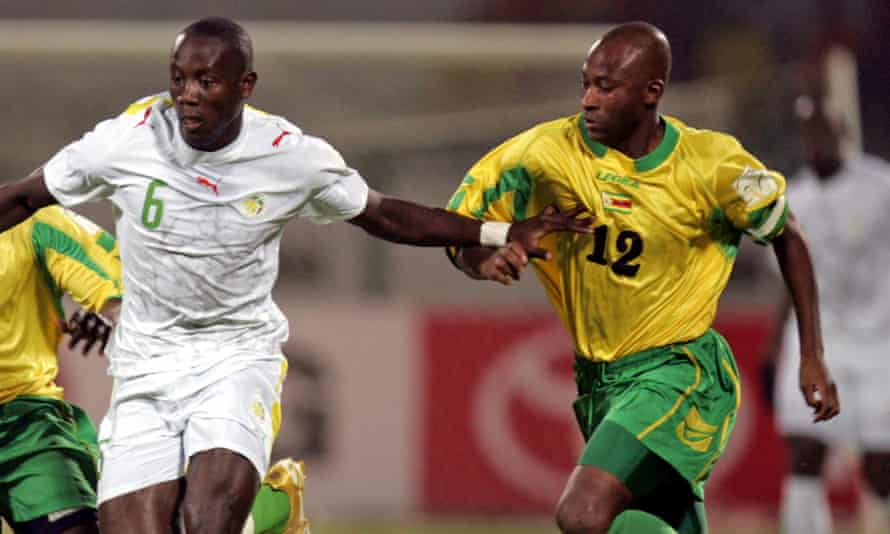 Peter Ndlovu, right, carried on playing for Zimbabwe until 2007. Here he challenges Senegal Rahmane Barry during a African Nations Cup game in Port Said, Egypt, in 2006.