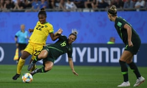 Jamaica's forward Kayla McCoy (left) vies for the ball with Australia's midfielder Katrina Gorry (centre) during the France 2019 Women's World Cup Group C football match.