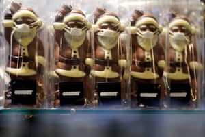 Chocolate Santa Clauses with face masks in Frankfurt am Mainepa08838598 Chocolate Santa Clauses with face masks stand in a confectionery shop during the coronavirus pandemic in Frankfurt am Main, Germany, 24 November 2020. Due to an increasing number of cases of the pandemic COVID-19 disease caused by the coronavirus SARS CoV-2, nationwide restrictions have been announced to counter a surge in infections, such as the closure of bars and restaurants. EPA/RONALD WITTEK