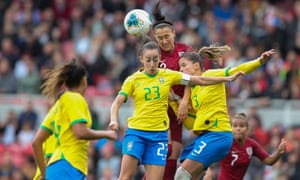 Lucy Bronze outjumps two Brazilians but the South American side beat England 2-1 at the Riverside.