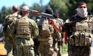 Fighters from the Kurdish People's Protection Units (YPG) in Syria