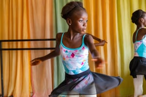 Chinemere Duru practises a pirouette while the other students wait for their turn