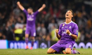 Real Madrid's Portuguese striker Cristiano Ronaldo falls to his knees as he celebrates their victory on the final whistle.