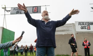 Sun god … Michael Eavis welcomes the first festivalgoers to Glastonbury 2019.
