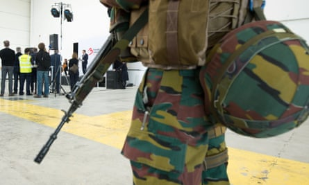 A soldier stands guard before flights resumed  at Brussels airport on Sunday