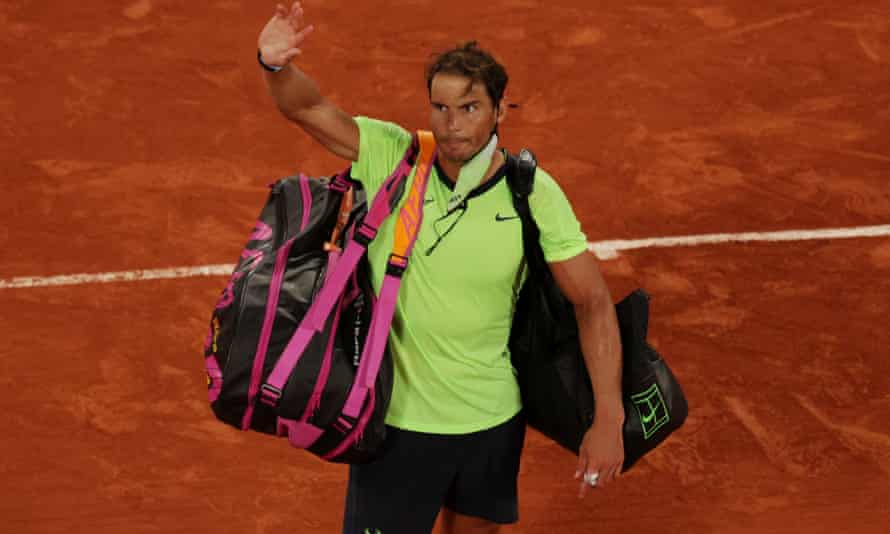Rafael Nadal waves to the crowd after his defeat in Paris