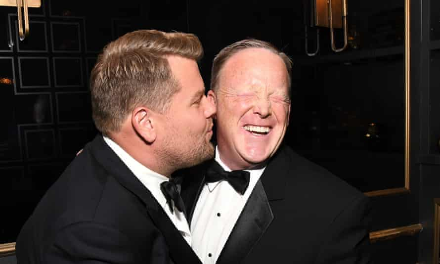 James Corden kisses Spicer at the Emmys.